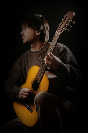 Acoustic guitar player. Classical guitarist playing guitar spanish isolated Banco de Imagens