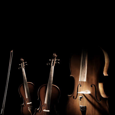 String instruments isolated. Violin, viola and cello musical instrument of orchestra. Classical music instruments isolated on black background 스톡 콘텐츠
