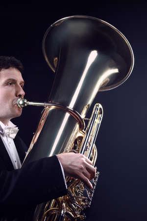 Tuba player brass instrument. Classical musician playing orchestra bass euphonium horn