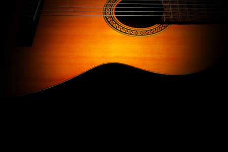 Acoustic guitar. Classical spanish guitar closeup. Musical instruments isolated on black background Banco de Imagens