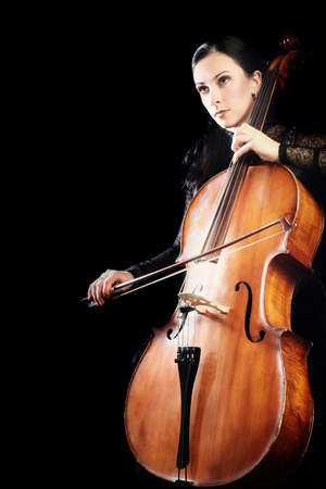 Cello player. Cellist playing violoncello classical musician isolated Banco de Imagens