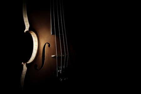 Violin orchestra musical instruments. Silhouette string closeup on black Banco de Imagens