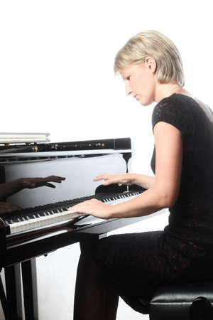 Piano player. Pianist playing grand piano concert. Classical musician