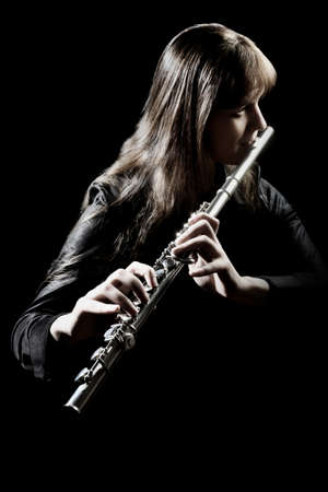 Flute player isolated. Flutist playing music instrument flute. Classical musician