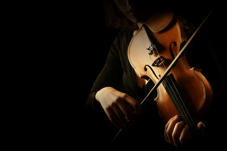 Violin player. Violinist hands playing violin orchestra musical instrument closeup