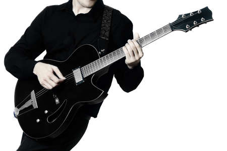 Guitar player. Guitarist playing electric guitar music instrument in hands closeup isolated on white