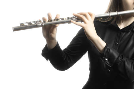 Flute instrument. Flutist hands playing flute isolated on white. Closeup of flute player
