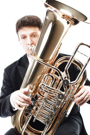 Tuba player brass instrument. Classical musician playing horn trumpet euphonium Banco de Imagens