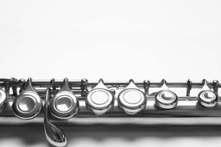 Flute instrument closeup. Orchestra woodwind music instruments close up. Flute isolated