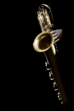 Saxophone player. Saxophonist hands playing jazz music instrument. Baritone sax player isolated Stock Photo
