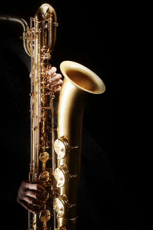 Saxophone player Saxophonist playing jazz music instrument. Baritone sax player Stock fotó