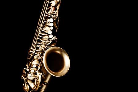 Saxophone jazz instruments. Alto sax closeup isolated on black