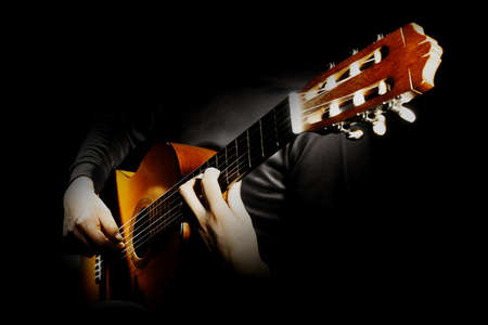 Acoustic guitar player. Classical guitarist playing spanish guitar closeup hands isolated