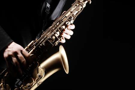Saxophone player. Saxophonist playing jazz music instrument. Sax player hands