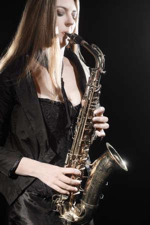 Saxophone player. Jazz musician saxophonist woman playing saxophone. Sax player Banco de Imagens