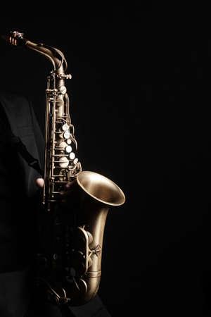 Saxophone player. Saxophonist hands playing jazz music instrument sax player