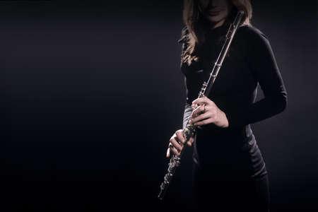 Flute player classical musician closeup. Woman with flute instrument portrait Banco de Imagens