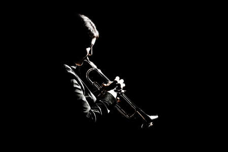 Trumpet player playing jazz musician. Woman playing trumpet brass instrument isolated Banco de Imagens