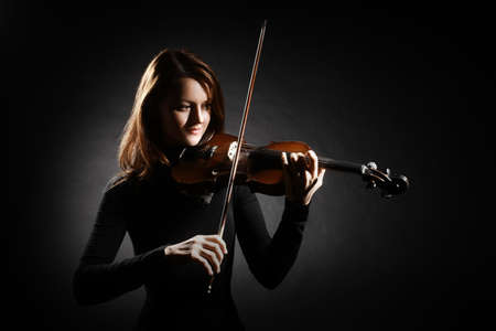 Violin player. Violinist classical musician woman playing violin musical instrument Banco de Imagens