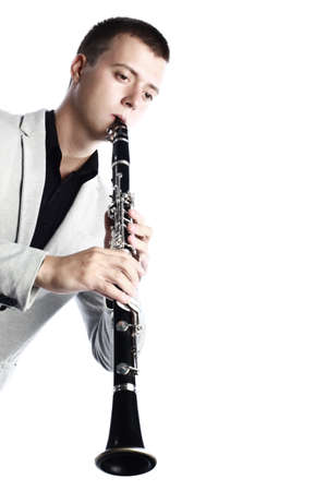 Clarinet player classical musician isolated. Man playing music woodwind instrument