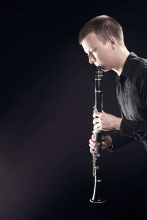 Clarinet player classical musician. Man playing orchestra music woodwind instrument