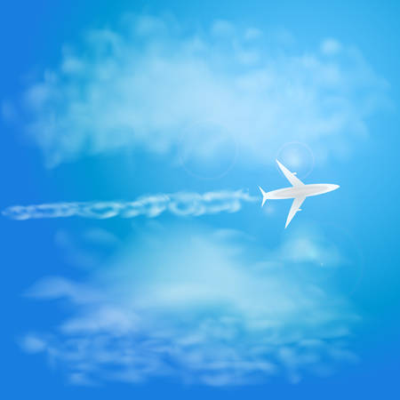 White plane flying with trail in blue sky with clouds.