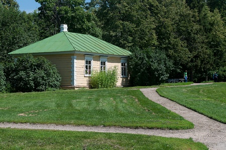 conducted: Small house in a thicket  To a small house conducted well-groomed tracks, a lawn just postrizhen  Stock Photo