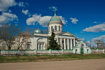 fenced in: Church in with. A red Pine forest. Old a church building fenced on perimetre a stone fence. Stock Photo