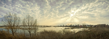 flood area: Panorama the Arzamas area. Spring evening panorama with a kind on small village in river flood. Stock Photo
