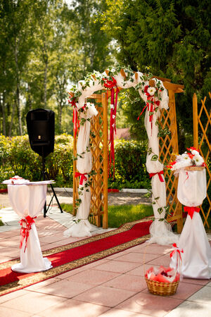 Beautiful arch for a registatsiya of wedding outdoors. photo