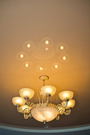 Beautiful beige lamp about reflection in a ceiling. photo