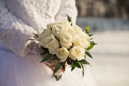 Bridal bouquet in hands in the winter. photo