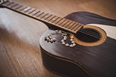 Old six-string guitar and ornaments on it. photo