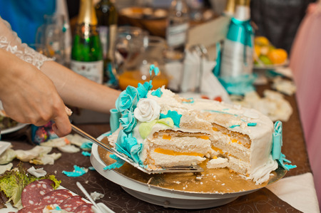 Process pie cutting on a festive table. photo