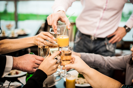 yellow to drink: Young people congratulate each other on a holiday or an event. Stock Photo