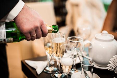 Process a champagne nalivaniye in a glass. photo
