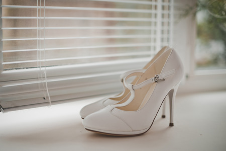 no heels: Ornaments and shoes of the bride prepared on wedding.