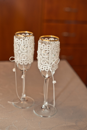 Beautiful transparent glasses decorated with an embroidery and pearls. photo