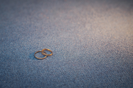 Two gold rings on a glass table. photo
