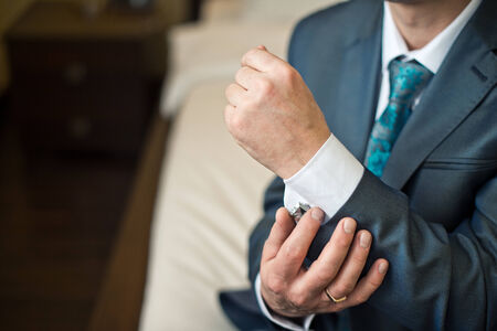 Hands of the young man clasping a shirt. photo