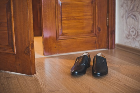 Boots about doors in a room. photo