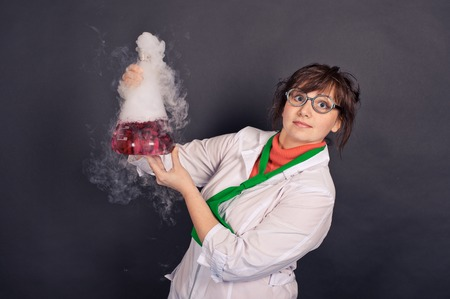 Creative scientists make experiments with liquid ice. 스톡 콘텐츠