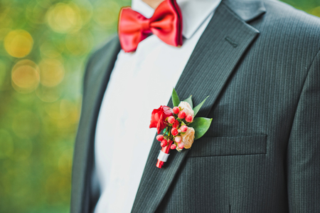 breast pocket: The man in a red butterfly and with a buttonhole.