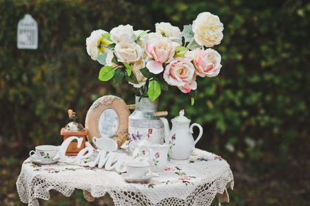 little table: Little table with flowers and beautiful things in a garden.