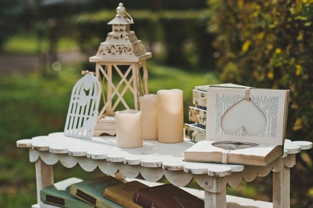 Little table with flowers and beautiful things in a garden.