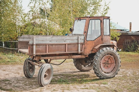 Old tractor of unknown model. photo