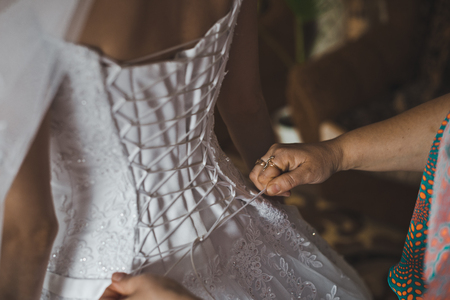 lace up: The bride lace up in a dress. Stock Photo