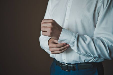 french cuffs: Process of clothing of a shirt. Stock Photo