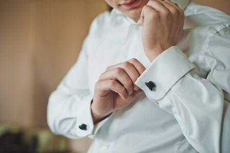suit  cuff: The young man dresses a shirt. Stock Photo