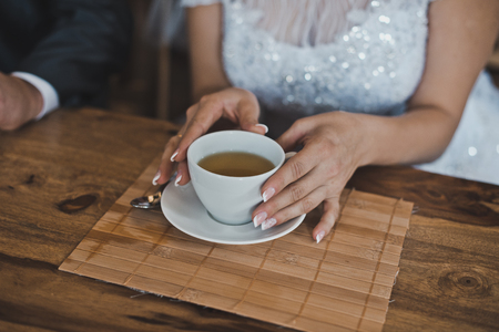 newly wedded couple: Young people drink tea. Stock Photo